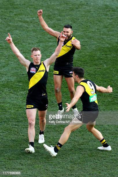 Jack Riewoldt , Trent Cotchin , and Shane Edwards of the Tigers celebrate during the 2019 AFL Grand Final match between the Richmond Tigers and the...