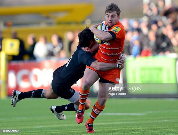 Jack Roberts of Leicester Tigers is challenged by Gonzalo Tiesi of Newcastle Falcons during the Aviva Premiership match between Newcastle Falcons and...