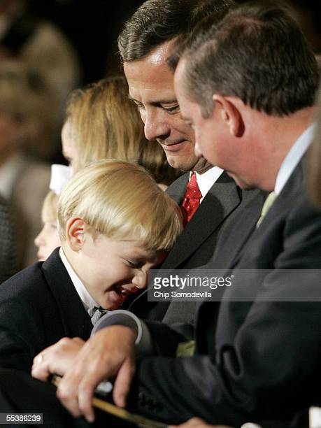 Jack Roberts son of US Supreme Court Chief Justice nominee John Roberts hugs his dad on the first day of confirmation hearings September 12 2005 at...