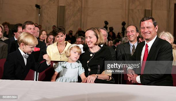 Jack Roberts son of US Supreme Court Chief Justice nominee John Roberts jokes with his father on the first day of confirmation hearings September 12...