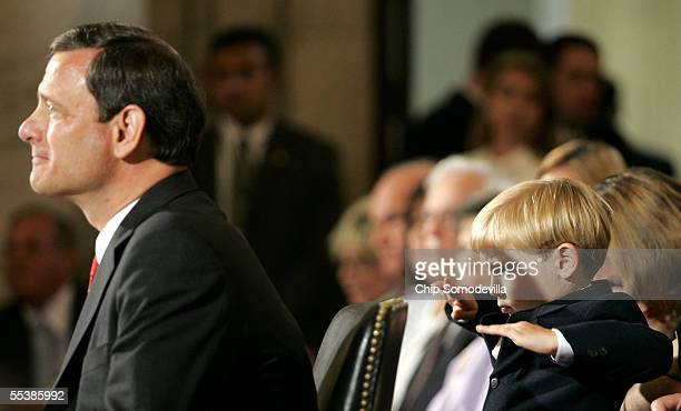 Jack Roberts son of US Supreme Court Chief Justice nominee John Roberts plays behind his father on the first day of confirmation hearings September...