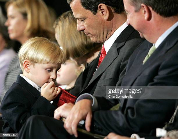 Jack Roberts son of US Supreme Court Chief Justice nominee John Roberts plays with his father's necktie on the first day of confirmation hearings...