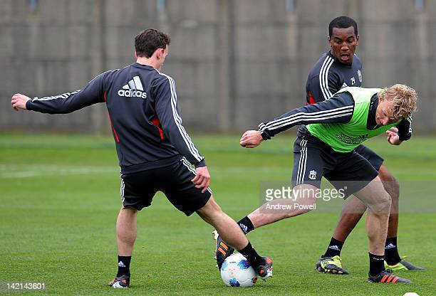 Jack Robinson, Andre Wisdom and Dirk Kuyt of Liverpool during a Liverpool training session at Melwood Training Ground on March 30, 2012 in Liverpool,...