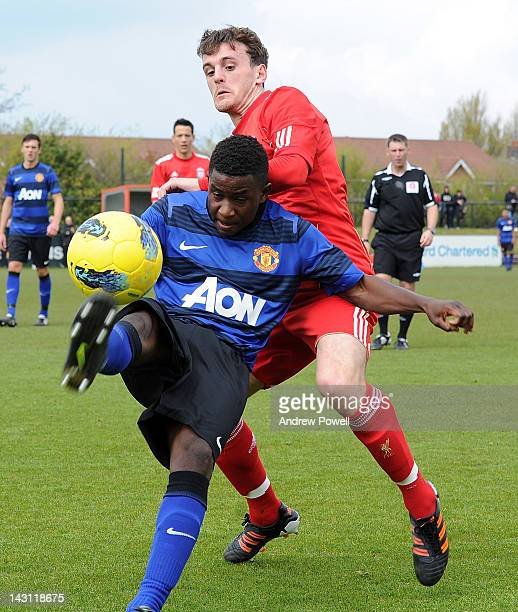 Jack Robinson of Liverpool competes with Larnell Cole of Manchester United during the Barclays Premier Reserve League between Liverpool Academy and...