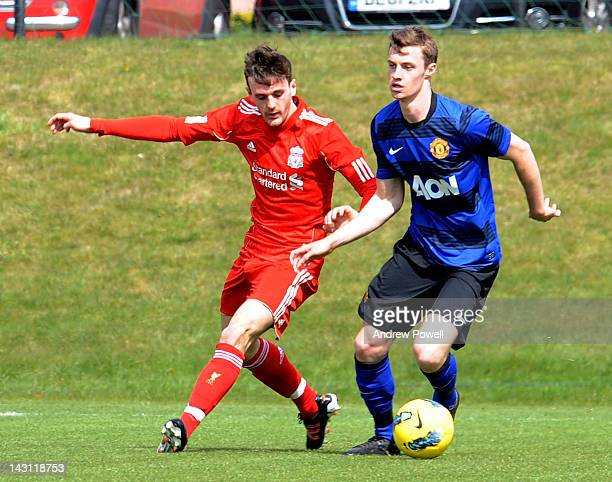 Jack Robinson of Liverpool competes with Michael Keane of Manchester United during the Barclays Premier Reserve League between Liverpool Academy and...