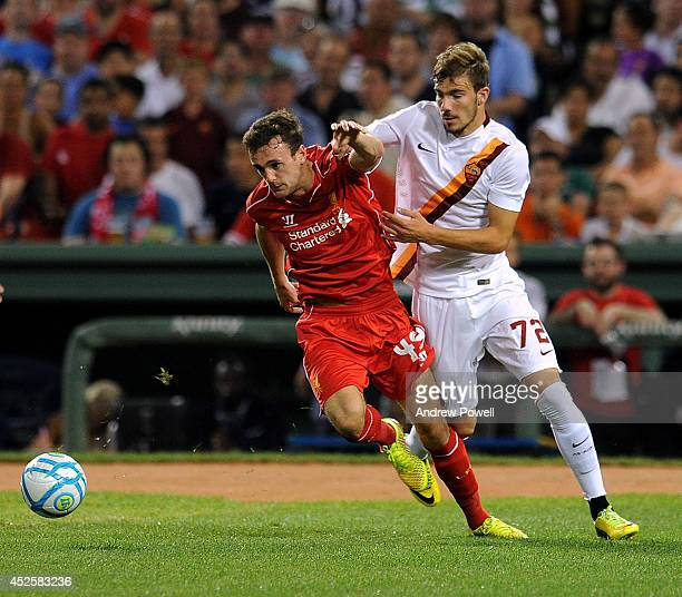 Jack Robinson of Liverpool competes with Mihao Alexsandru Balgsa of AS Roma during the preseason friendly match between Liverpool FC and AS Roma at...