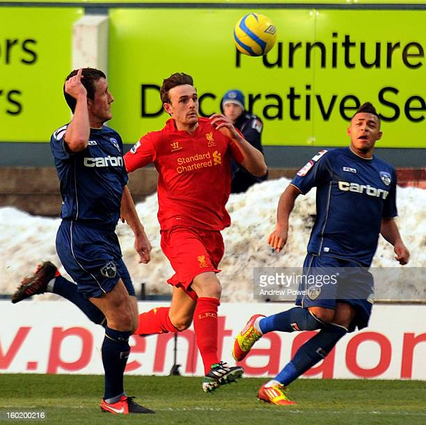 Jack Robinson of Liverpool competes with Reece Wabara and Robbie Simpson of Oldham Athletic during the FA Cup Fourth Round match between Oldham...