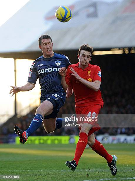 Jack Robinson of Liverpool competes with Robbie Simpson of Oldham Athletic during the FA Cup Fourth Round match between Oldham Athletic and Liverpool...
