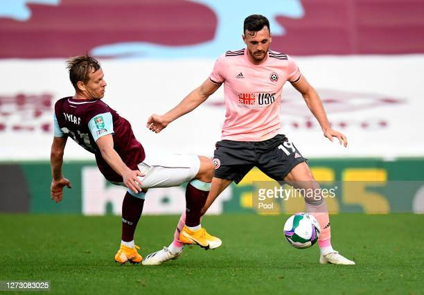 Jack Robinson of Sheffield United battles for possession with Matej Vydra of Burnley during the Carabao Cup second round match between Burnley and...