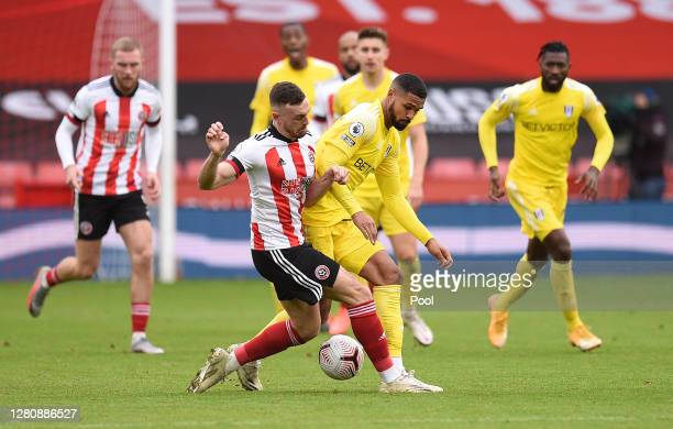 Jack Robinson of Sheffield United battles for possession with Ruben LoftusCheek of Fulham during the Premier League match between Sheffield United...