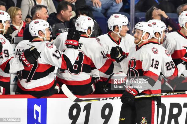 Jack Rodewald of the Belleville Senators celebrates his first period goal with teammates on the bench against the Laval Rocket during the AHL game at...