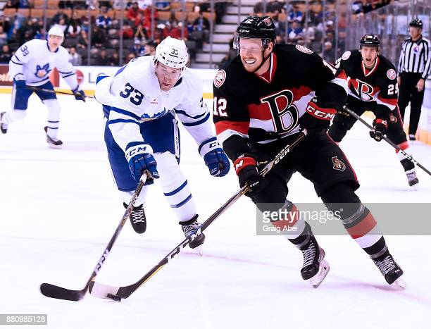 Jack Rodewald of the Belleville Senators controls the puck against Frederik Gauthier of the Toronto Marlies during AHL game action on November 25...
