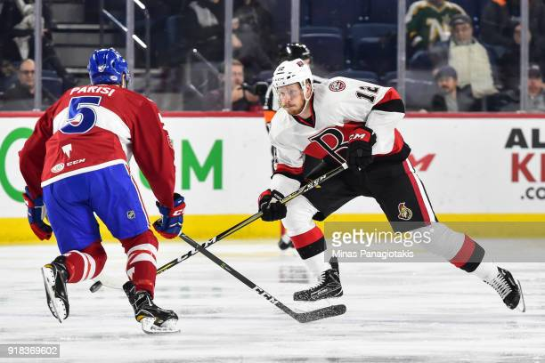 Jack Rodewald of the Belleville Senators skates the puck against Tom Parisi of the Laval Rocket during the AHL game at Place Bell on February 14 2018...