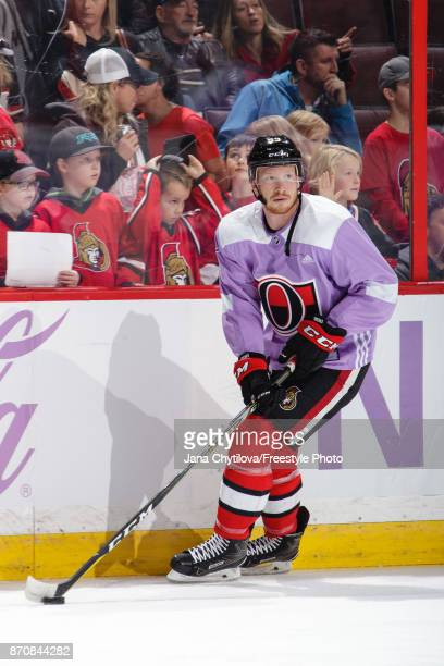 Jack Rodewald of the Ottawa Senators wears a jersey dedicated to the NHL's annual Hockey Fights Cancer Awareness Night as he skates during warmups...