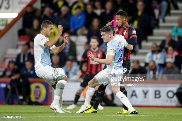 Jack Rodwell and Darragh Lenihan of Blackburn Rovers with Lys Mousset of Bournemouth during the Carabao Cup Third Round match between AFC Bournemouth...