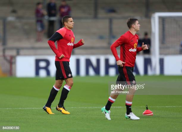 Jack Rodwell and Donald Love of Sunderland warming up before the Checkertrade Trophy group stage match at Glanford Park on August 29 2017 in...