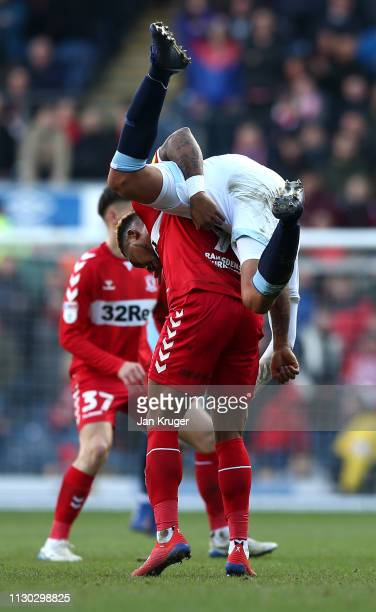 Jack Rodwell of Blackburn Rovers tussles with Britt Assombalonga of Middlesbrough during the Sky Bet Championship match between Blackburn Rovers and...