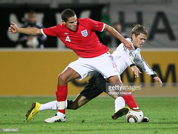 Jack Rodwell of England challenges Boris Vukcevic of Germany during the U21 international friendly match between Germany and England at at the Brita...