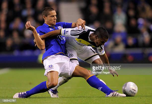 Jack Rodwell of Everton tangles with Florent Malouda of Chelsea during the Carling Cup Fourth Round match between Everton and Chelsea at Goodison...