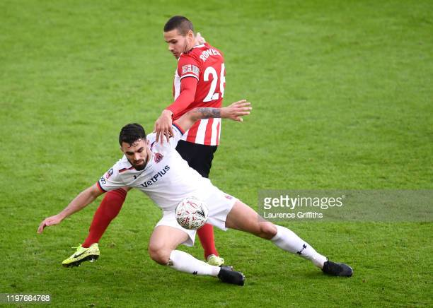 Jack Rodwell of Sheffield United battles for possession with Jordan Williams of AFC Flyde during the FA Cup Third Round match between Sheffield...