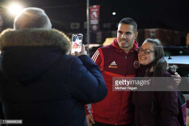 Jack Rodwell of Sheffield United poses for a photograph with a fan ahead of the Premier League match between Sheffield United and West Ham United at...