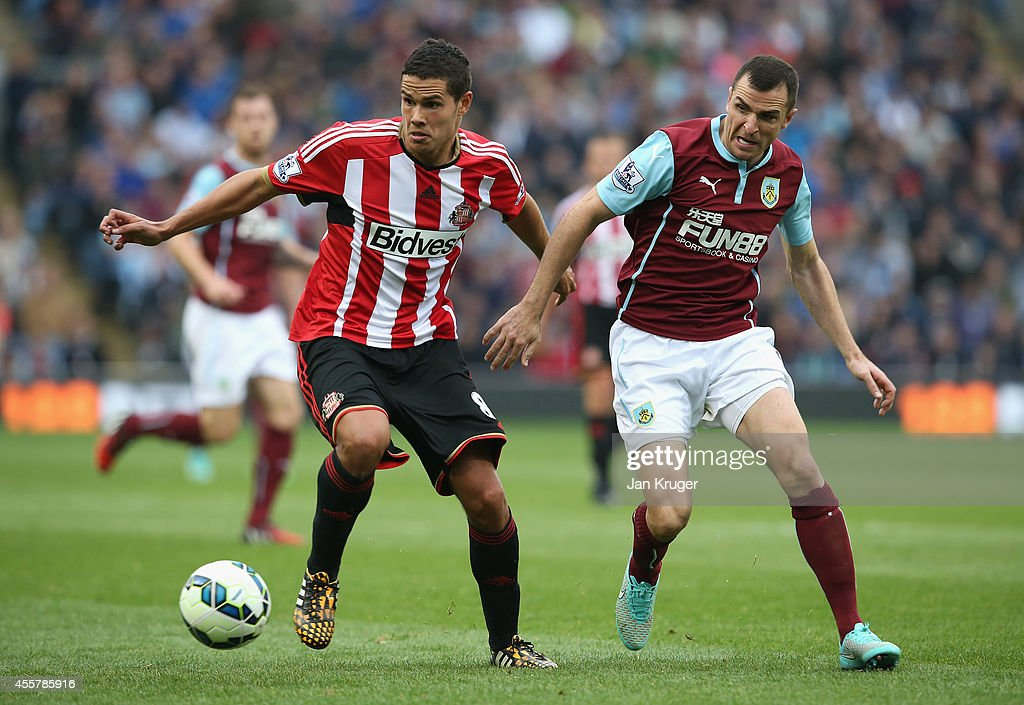 Jack Rodwell of Sunderland competes with Dean Marney of Burnley during the Barclays Premier League match between Burnley and Sunderland at Turf Moor on September 20, 2014 in Burnley, England.