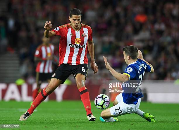 Jack Rodwell of Sunderland is tackled by Seamus Coleman of Everton during the Premier League match between Sunderland and Everton at Stadium of Light...