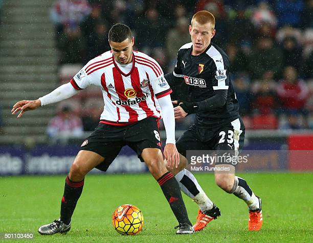 Jack Rodwell of Sunderland is tracked by Ben Watson of Watford during the Barclays Premier League match between Sunderland AFC and Watford FC at the...