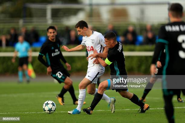 Jack Roles of Tottenham Hotspur and Gorka Zabarte of Real Madrid compete for the ball during the UEFA Youth League group H match between Tottenham...