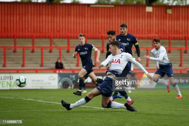 Jack Roles of Tottenham Hotspur scores his team's first goal during the Premier League 2 match between Tottenham Hotspur and Derby County at The...