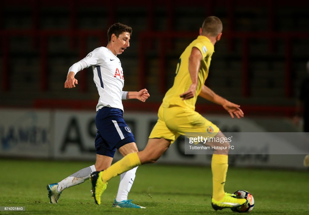 Jack Roles of Tottenham runs at Ramon Bueno of Villarreal during the Premier League International Cup match between Tottenham Hotspur and Villarreal at The Lamex Stadium on November 14, 2017 in Stevenage, England.