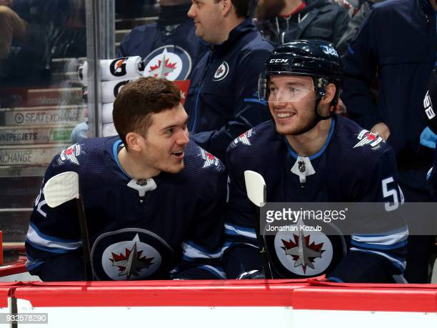 Jack Roslovic and Marko Dano of the Winnipeg Jets share a laugh at the bench prior to puck drop against the Chicago Blackhawks at the Bell MTS Place...