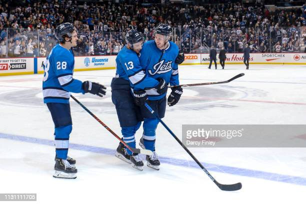Jack Roslovic Brandon Tanev and Kevin Hayes of the Winnipeg Jets are all smiles as they celebrate a 21 victory over the Calgary Flames at the Bell...