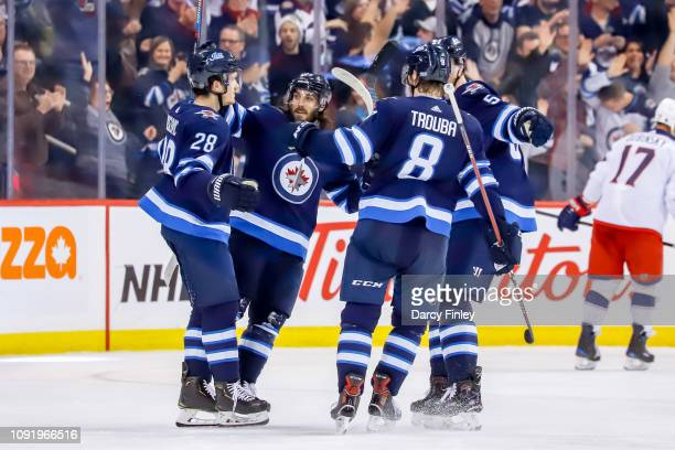 Jack Roslovic Mathieu Perreault Jacob Trouba and Tyler Myers of the Winnipeg Jets celebrate a third period goal against the Columbus Blue Jackets at...