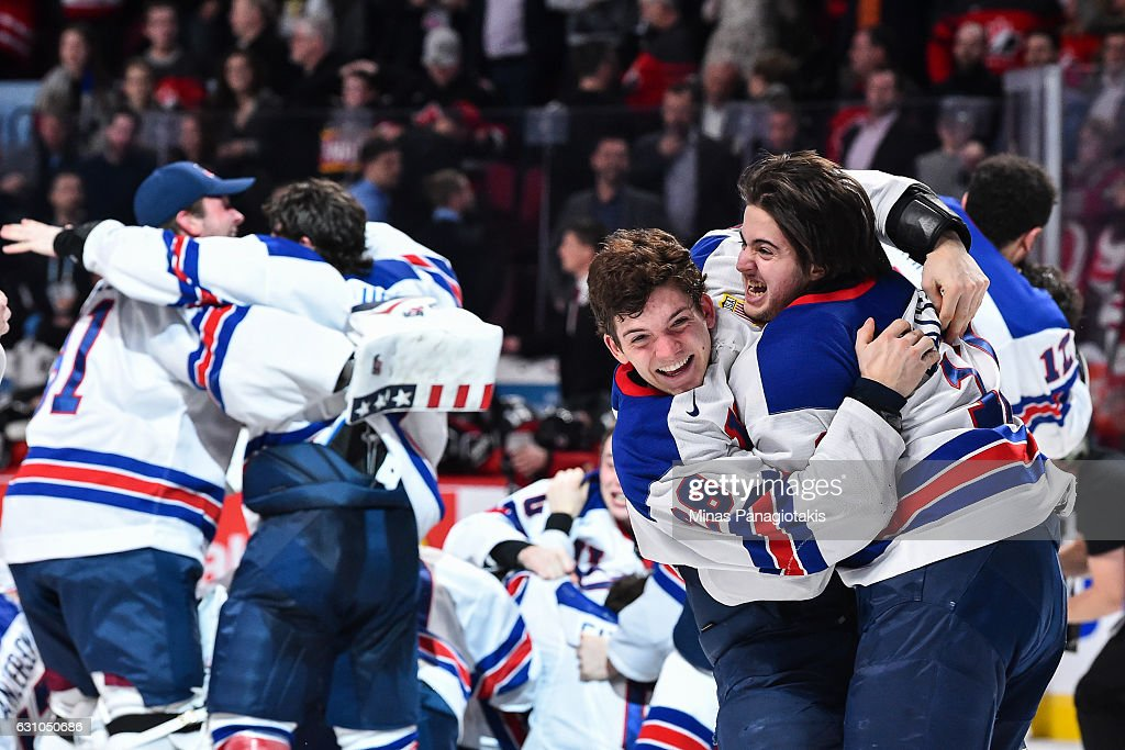 Jack Roslovic #28 of Team United States and teammate Jeremy Bracco #17 hug it out after defeating Team Canada during the 2017 IIHF World Junior Championship gold medal game at the Bell Centre on January 5, 2017 in Montreal, Quebec, Canada. Team United States defeats Team Canada 5-4 in a shootout and wins the gold medal round.