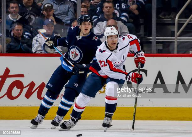 Jack Roslovic of the Winnipeg Jets and Madison Bowey of the Washington Capitals keep an eye on the play during third period action at the Bell MTS...