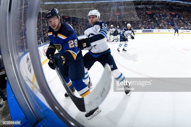 Jack Roslovic of the Winnipeg Jets checks Vince Dunn of the St Louis Blues at Scottrade Center on February 23 2018 in St Louis Missouri