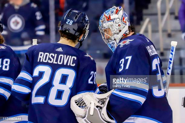 Jack Roslovic of the Winnipeg Jets congratulates goaltender Connor Hellebuyck following a 43 victory over the New York Rangers at the Bell MTS Place...
