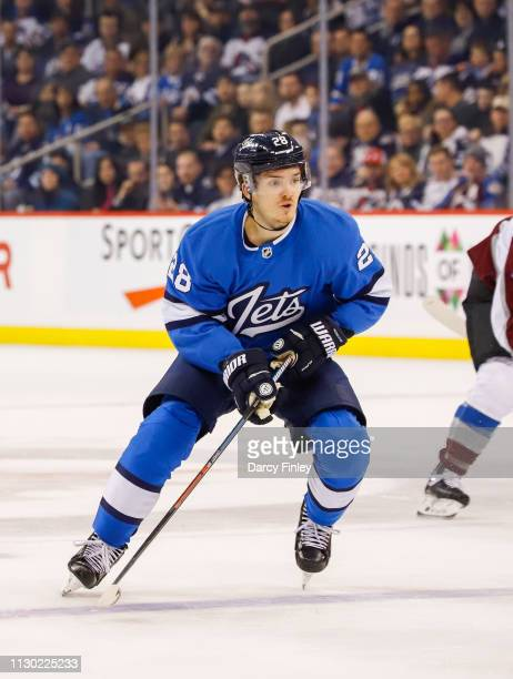 Jack Roslovic of the Winnipeg Jets follows the play down the ice during first period action against the Colorado Avalanche at the Bell MTS Place on...