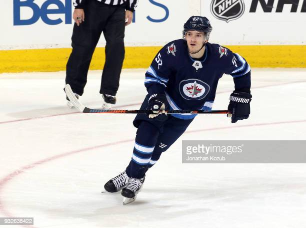 Jack Roslovic of the Winnipeg Jets follows the play up the ice during third period action against the Chicago Blackhawks at the Bell MTS Place on...