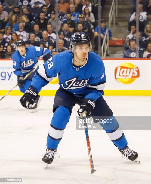 Jack Roslovic of the Winnipeg Jets keeps an eye on the play during first period action against the St Louis Blues at the Bell MTS Place on December 7...