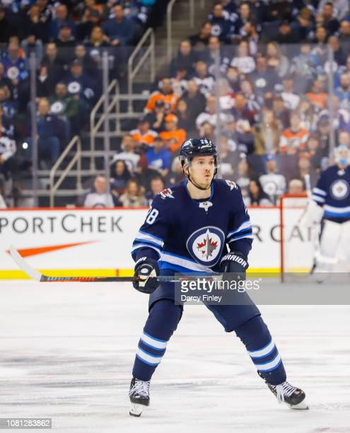 Jack Roslovic of the Winnipeg Jets keeps an eye on the play during second period action against the Philadelphia Flyers at the Bell MTS Place on...