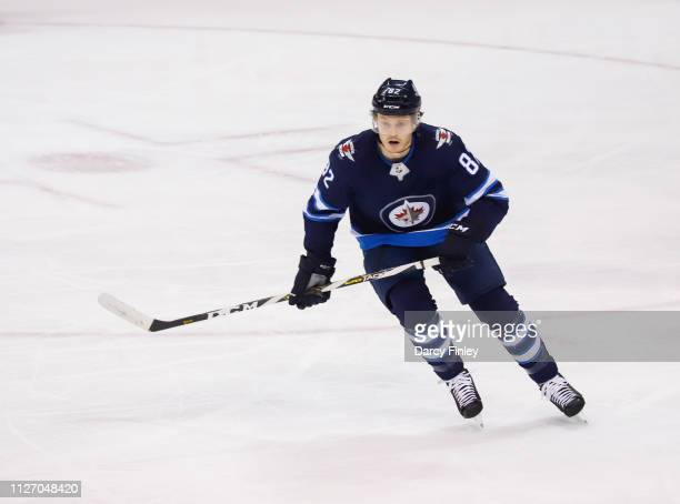 Jack Roslovic of the Winnipeg Jets keeps an eye on the play during second period action against the Columbus Blue Jackets at the Bell MTS Place on...
