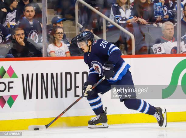 Jack Roslovic of the Winnipeg Jets plays the puck along the boards during second period action against the Philadelphia Flyers at the Bell MTS Place...