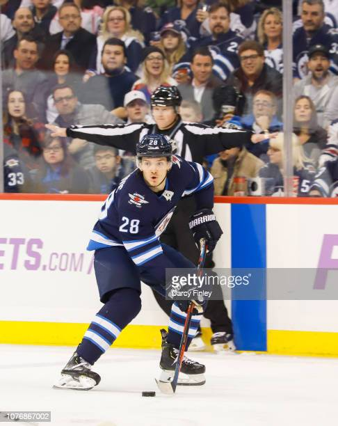 Jack Roslovic of the Winnipeg Jets plays the puck down the ice during first period action against the Chicago Blackhawks at the Bell MTS Place on...