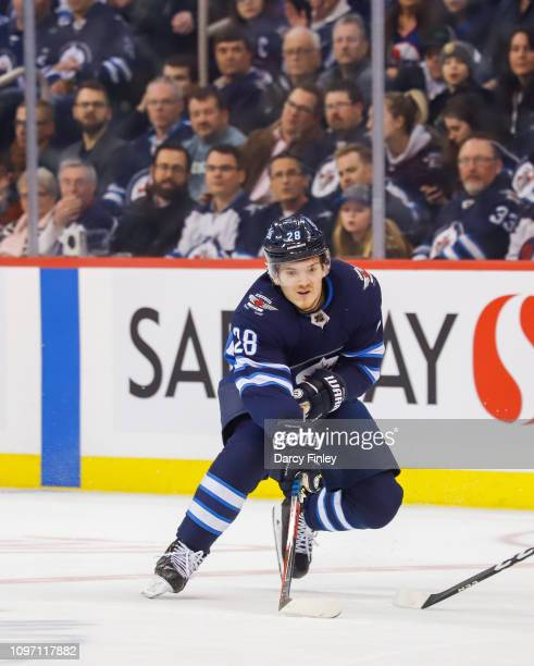Jack Roslovic of the Winnipeg Jets plays the puck down the ice during first period action against the Vegas Golden Knights at the Bell MTS Place on...