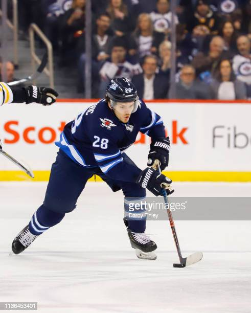 Jack Roslovic of the Winnipeg Jets plays the puck down the ice during first period action against the Boston Bruins at the Bell MTS Place on March 14...