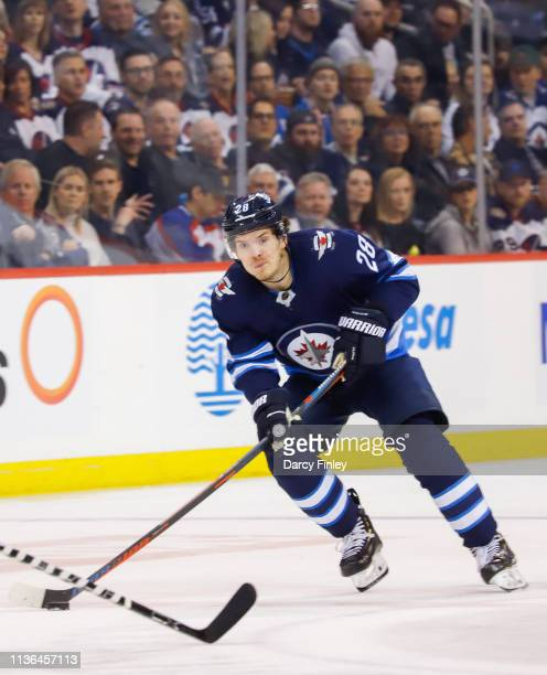 Jack Roslovic of the Winnipeg Jets plays the puck down the ice during second period action against the San Jose Sharks at the Bell MTS Place on March...
