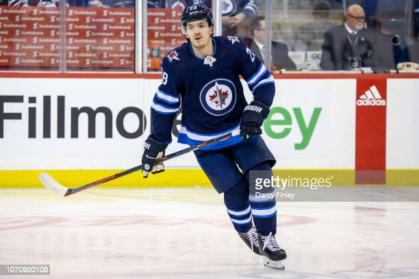 Jack Roslovic of the Winnipeg Jets takes part in the pregame warm up prior to NHL action against the Philadelphia Flyers at the Bell MTS Place on...