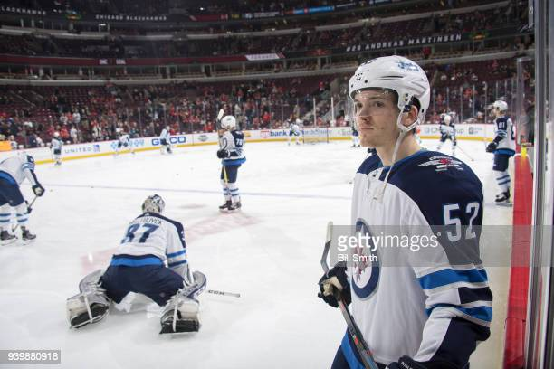 Jack Roslovic of the Winnipeg Jets warms up prior to the game against the Chicago Blackhawks at the United Center on March 29 2018 in Chicago Illinois
